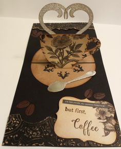 "Elizabeth Craft Designs:  Coffee Pop Stand (Pop it Ups); Coffee & Tea clear stamps; Coffee stage-it stencil.  Kaisercraft ""Art of Life"" paper; Tim Holtz Deco sheets (for steam), Ground Espresso distress ink and Vintage Photo Embossing Powder.  Photo 2 of 2"