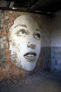 Reverse graffiti, also known as clean tagging, dust tagging, grime writing, green graffiti or clean advertising, is a method of creating temporary or semi permanent images on walls or other surfaces by removing dirt from a surface. | Vhils, Porto