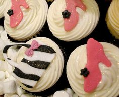 Custom zebra and hot pink fondant shoes and purses on Vanilla Elegance and Moulin Rouge cupcakes for a birthday.