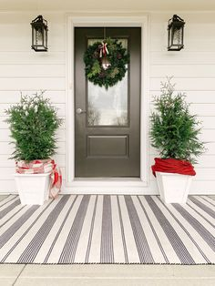 Cheerful Winter Front Porch Farmhouse Area Rugs, Farmhouse Front, Carrara Marble Kitchen, Kitchen Liners, White Siding, Outdoor Seating, Outdoor Decor, Wooden Planters, Farmhouse Lighting
