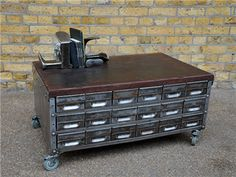 Polished steel coffee table and storage. 36 drawers under a well-worn reclaimed workbench top.  origin: UK  year: 1960  dimensions: width: 92cm; height: 44cm; depth: 59cm