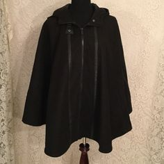 Sporto cape style hooded coat New   Zippered front,  cape style coat,   Has 2 snaps inside to make sleeves , so it can be worn as a coat or cape ,  hooded,  lined,  nice, heavy 85% polyester,  10% wool , Sporto Jackets & Coats Capes
