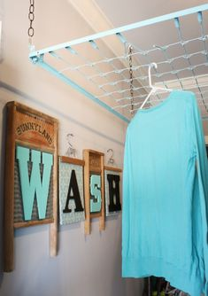 love the wash sign. also, i love the use of the old bed springs as a drying rack.