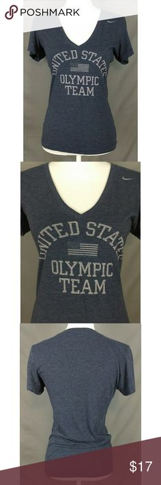 Nike Blue Olympic Team Slim Fit V-Neck Tee Size M Size: M Color: Blue Design: USA Olympic Team Slim Fit V-Neck Tee Shirt Neckline: V-Neck Sleeves: Short Materials: 50% Polyester, 25% Cotton, and 25% Rayon  Measurements (approximate) Length: 24in Underarm to underarm (laying flat): 17in  Condition:Gently used pre-owned. No rips, tears, or stains. Nike Tops Tees - Short Sleeve