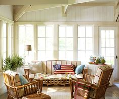 Another sunroom/enclosed porch idea with a relaxing casual feel. I especially like the patriotic pillow.