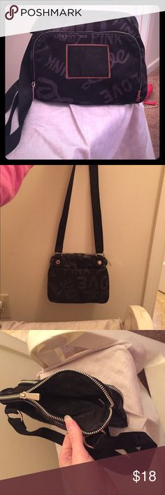 Victoria's secret PINK cross body Black Victoria's secret PINK cross body bag with adjustable strap. Has several zipper pockets and is a great size for every day or traveling. Soft satin like material. PINK Victoria's Secret Bags Crossbody Bags