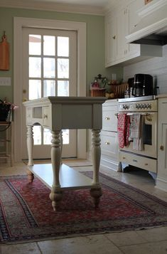 DIY Kitchen Island from sofa table with new feet & butcher block top.