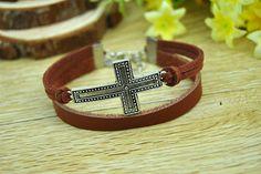 Brown leather cord braceletSilvery alloy crossCharm by Richardwu, $4.50