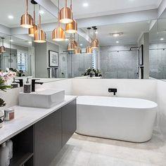 Bathroom Inspo! Eden Brae Homes Bristol Display featuring the Caroma Aura Freestanding Bath  #Caroma #inspiringbathrooms #weeklyhometrends #design #styling #bathroominspo #copperpendants #blacktapware
