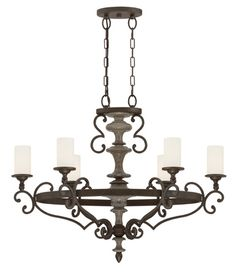 The dramatic black Strathmore six-light chandelier by @savoyhouse casts a stately silhouette.