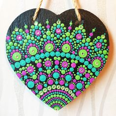 A personal favourite from my Etsy shop https://www.etsy.com/uk/listing/588803159/hanging-heart-mandala-art-work-slate