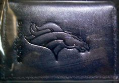 NFL Officially Licensed Denver Broncos Tri-Fold Leather Wallet (Black) by Rico. $22.99. Talk about class, this 100% genuine leather wallet, made by Rico, is meticulously crafted with your favorite team's name embossed on the front.  There's a large bill compartment, credit card side pockets and a vinyl insert for pictures or additional credit cards.  This wallet is a must-have for any sports fan.. Save 23% Off!