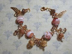 Gold Wire Wrapped Bracelet using Carmelo Glass Beads, & other Beads, and Angel Wings .. FOR SALE .. $47.00 SHIPPING IS INCLUDED IN PRICE