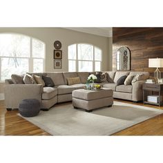 Enjoy a spacious sectional for entertaining with this 4-piece set with a cuddler. The UltraPlush seat cushions are reversible, so you can enjoy supreme comfort and rotate your cushions for more even wear. The neutral fabric and inviting contemporary design with large rolled arms will create a welcoming environment in your home.