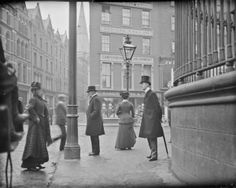 Man with umbrella, Nassau Street, Dublin. ca. 1890-1900