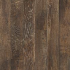 Mannington laminate flooring. From the Restoration Collection: Historic Oak in Charcoal. Possible flooring choice for basement reno.