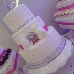White,silver and fushia wedding cake