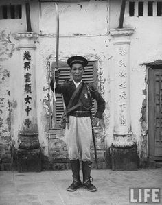 1948 – French Indo China Tran Dang Man lifting his sword in token of shift of allegiance to French.