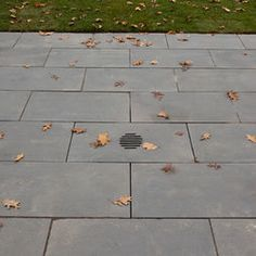 Elegant Waltham Watch Factory Cobblestone runnels direct water away from buildings and into the rain gardens