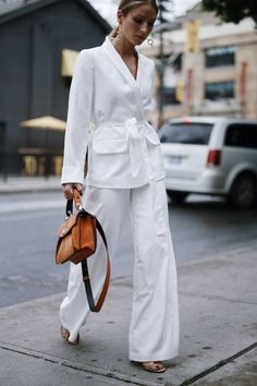 Style and beauty blogger Jill Lansky of The August Diaries wearing a white silk summer suit