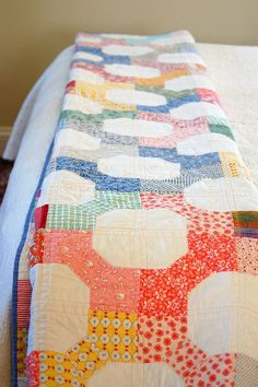 bow tie quilt - what a great quilt - I would make it a snowball quilt - bow ties the same around each white circle and then embroider in the circles.
