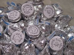 Hershey kisses with little stickers on the bottoms with sweet little wedding sayings.