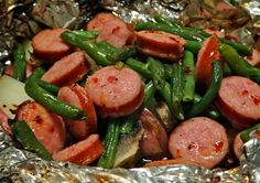 Camping Recipe: Hobo packets: Smoked Sausage, Potatoes & Green Beans Foil Packet (this might be a good idea for arrival day. Pre-cook the sausage, bake the potato. Would hardly take anytime at all to have dinner ready!)