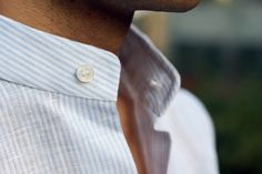 Crisply ironed shirt with a thin, sky blue ticking stripe