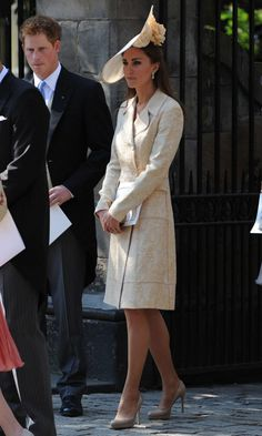 Kate Middleton Recycled A Gold Brocade Coat She Had Worn In 2006 To The Wedding Of Zara Phillips And Mike Tindall, 2011