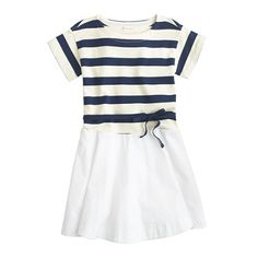 """Make headway in the morning routine with this easy to wear (and easier to love) A-line dress. Made from soft cotton on top with with a poplin skirt, it's finished with a pretty ribbon bow at the waist and nautical stripes. We'd say that it's a dress that will """"make waves"""", but that would be corny. <ul><li>A-line silhouette.</li><li>Falls above knee.</li><li>Cotton.</li><li>Machine wash.</li><li>Import.</li><li>Online only.</li></ul>"""