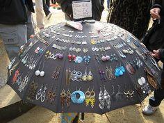 Earrings stuck through an umbrella for display