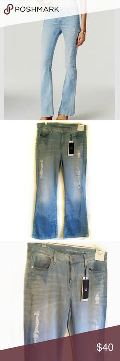 Calvin Klein Jeans Flared Bourges Distressed 32 Bourges Flare Leg Jeans Mid Rise Slim through hip and thigh. Gently Flares at knee Light Wash with Intentional Distressing (rips, holes, fading) 5 Pocket Style Belt Loops Machine Washable 98% Cotton; 2% Elastane New With Tags $89  Size: W32 x L32 Waist: 17 inches across Rise: 10 inches Inseam: 32 inches  Leg Opening: 11 inches across Calvin Klein Jeans Flare & Wide Leg