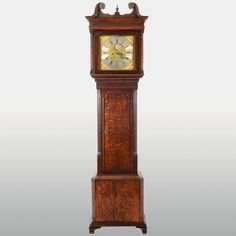 Antique English rare moon phase Jeremiah Standing tall case clock, circa 1780. The tiger oak tall case clock is engraved with a gilt calendar dial with a rare centered moon phase with a silver chapter ring and eight day gong strike movement. Restored with a one year warranty.