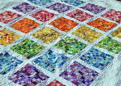 Google Image Result for http://memberfiles.freewebs.com/98/79/66067998/photos/Audreys-Quilts/rainbow%2520front.jpg