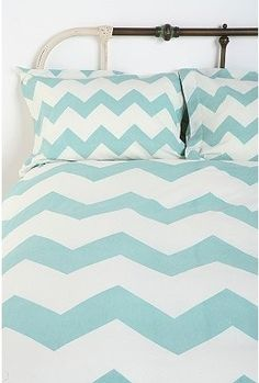 Blue bedding from urban outfitters (use same pattern/color for couches)