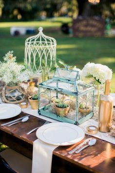 Rustic terrariums and gilded details: http://www.stylemepretty.com/south-carolina-weddings/2015/07/10/rustic-fall-wedding-at-litchfield-plantation/ | Photography: Studio 1250 - http://www.studio1250.com/