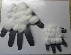 Handprint sheep craft with cotton balls- a Mommy handprint sheep and a baby handprint sheep.