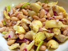 Slice of Southern: Artichoke and White Bean Salad. 1/4 cup olive oil 2 T lemon juice 1/2 garlic clove, minced 1/2 t Dijon mustard 1/8 t red pepper flakes Salt and pepper 1 14oz can of artichoke hearts in water, quartered 1 14oz can white beans, rinsed and drained (recommend Bush's) 1/2 small red onion, diced 1 celery stalk, thinly sliced 1 T fresh oregano, chopped