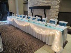 I like this for the head table. If the head table has white linen maybe navy draping with the lights? Head Table Wedding Decorations, Bridal Party Tables, Head Table Decor, Decoration Table, Wedding Centerpieces, Wedding Table, Tall Centerpiece, Centerpiece Ideas, Wedding Ideas