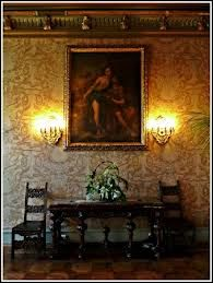 Decor: Castle home wall decor with wall sconces and medieval painting