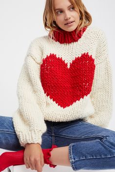 Happy Hearts Sweater | Handmade in New Zealand, this delicate yet chunky knit wool sweater features a super sweet heart design on the front.