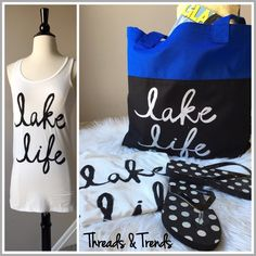 "2 Piece Set ""Lake Life"" Tee & Tote For all you summer lake lovers. Here is your summer fashion statement. Razor back tank ""Lake Life"" tee plus a royal and black shoulder tote with ""Lake Life"" graphic print. Tee made of rayon and spandex. Tote made of mayanmar polyester. Size S, M, L.                                               Small  Bust 32"" Length 28"" Medium  Bust 36"" Length 29"" Large  Bust 38"" Length 29"" Threads & Trends Tops"