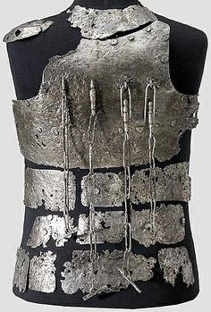 European coat of plates (fragments), 14th c, from the castle Hirschenstein near Passau,  consisting of a chest plate with four weapon chains, 30 plates of body armor for the abdomen, sides, back and shoulders.   Extremely rare armor type, preserved only in a few small fragments around the world. In particular, the breastplate with attached weapon chains was previously known only from early pictures and grave monuments.