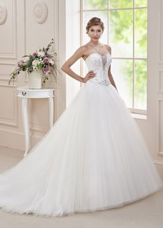 10a19e6c3768cf A full sumptuous fairytale full tulle dress with an intricate beaded  embroidery over corseted bodice and