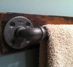 Towel Bar. Industrial. Rustic. DIY. Could do a toilet paper holder too with only one flange and leave the pipe open at other end.