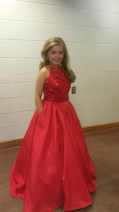 Chloe Howe, USA National Miss Texas Preteen 2016, looks absolutely adorable in this red Sherri Hill ball gown!  The Color -   The bright red color looks great on Chloe! Red can definitely be a sexier color for some contestants, but this brighter hue, paired with the glitzy bodice and Chloe's gorgeous blonde curls, is bright, fun and totally preteen appropriate!