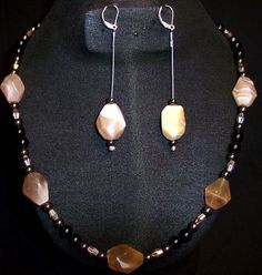 Faceted Botswana Agate nuggets,Black onyx and hematite round beads,Faceted silver cone spacers (22inches) $75.00