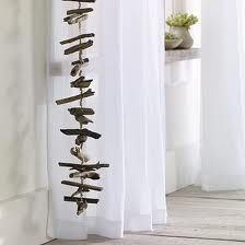 driftwood - this could be a neat room divider or funky casual window screen if you hung the driftwood vertically and had multiple strands