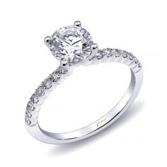 2c04b7867 This delicately tailored #engagement ring features a #diamond encrusted  shank with #scalloped sides