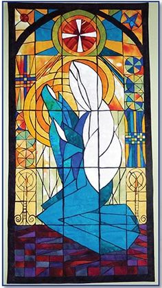 Madonna and child stained glass wall quilt pattern at Fern Hill.  Designed by Stephanie Brandenburg and Mary Patterson. Inspired by a painting by Richard Anderson.
